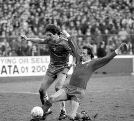 colin-lee-of-chelsea-is-tackled-by-phil-neal-of-liverpool-during-the-picture-id1.jpg